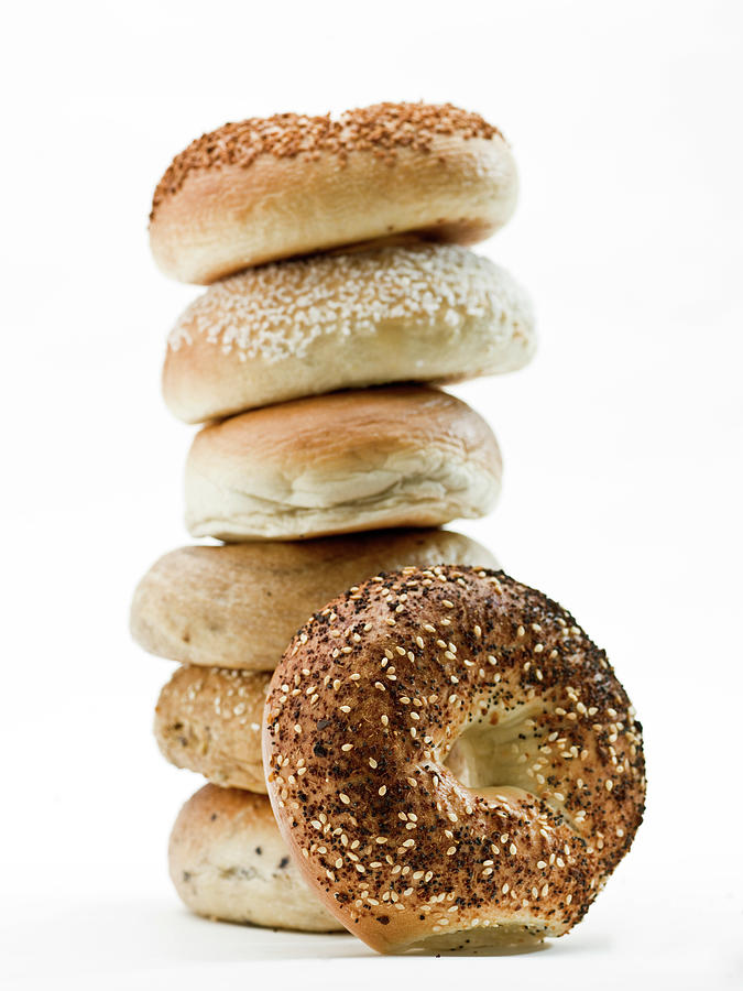 Stack Of Assorted Bagels Photograph by Juanmonino