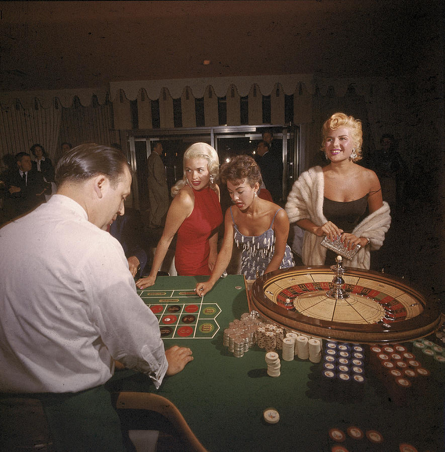 Stars At The Roulette Table Photograph by Loomis Dean
