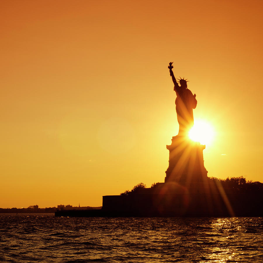 Statue Of Liberty Silhouetted At Dusk - Photograph by Franckreporter