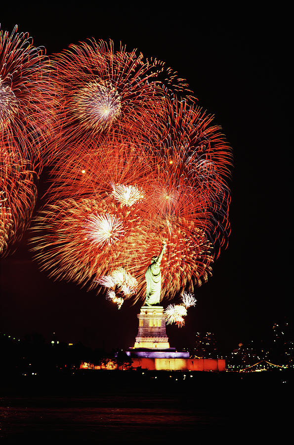 Statue Of Liberty With Fireworks Photograph by Jupiterimages