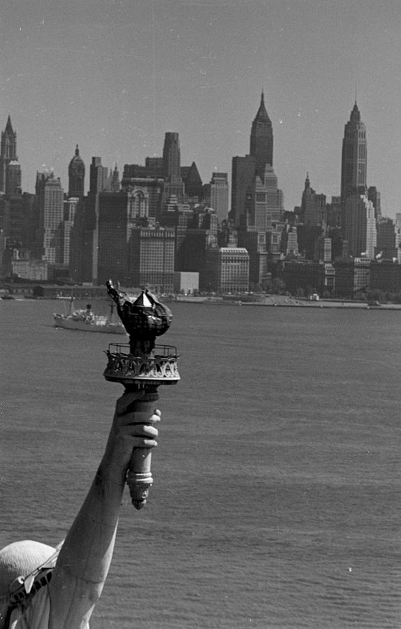 Statue Of Liberty With Manhattan In Photograph by Margaret Bourke-white
