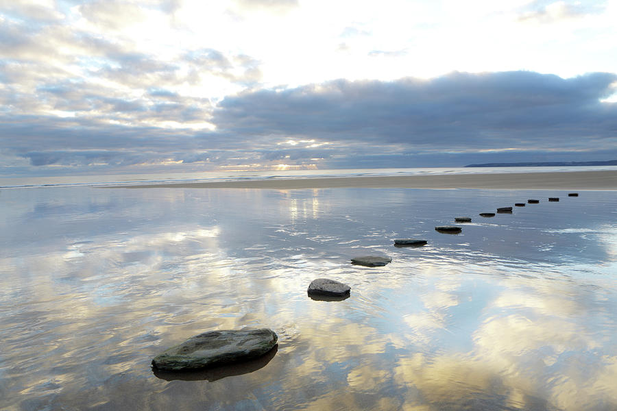 Stepping Stones Over Water With Sky Photograph by Peter Cade