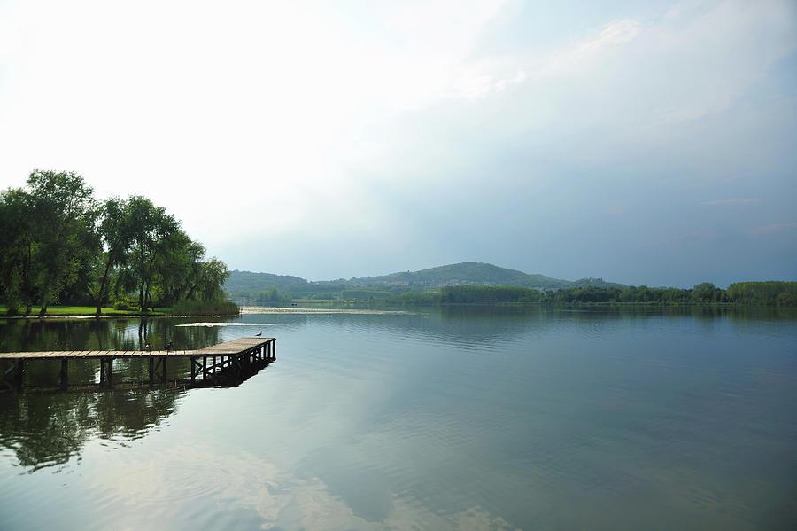 Still Lake Under Blue Sky Photograph by Daniela Buoncristiani