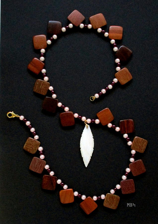 Beadwork Photograph - Still Life Of A Necklace Made From Wood Squares, Glass Pearls And A Shell Feather by Mike Smetzer