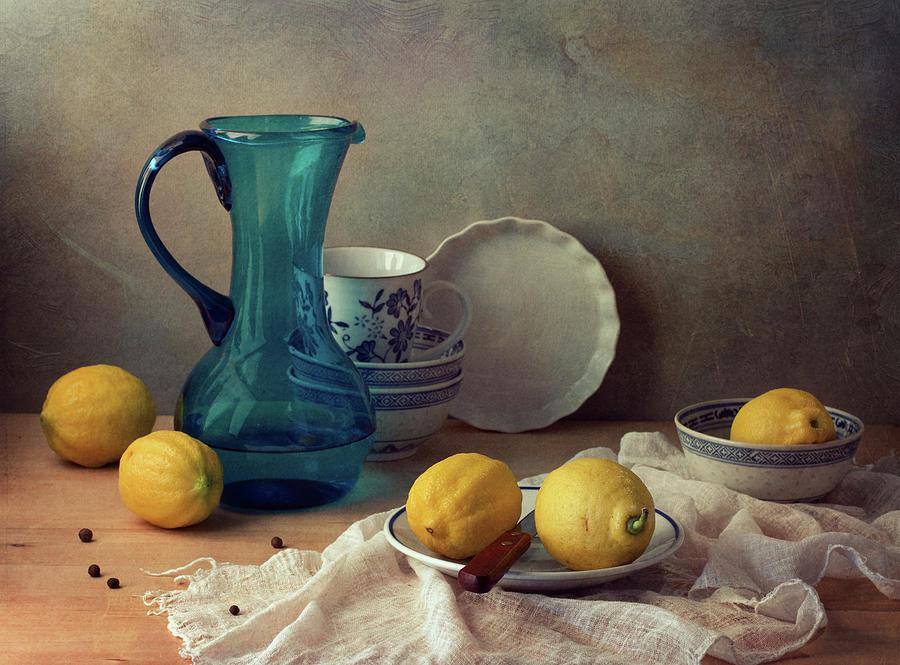 Still Life With Lemons And Blue Glass Photograph by Copyright Anna Nemoy(xaomena)