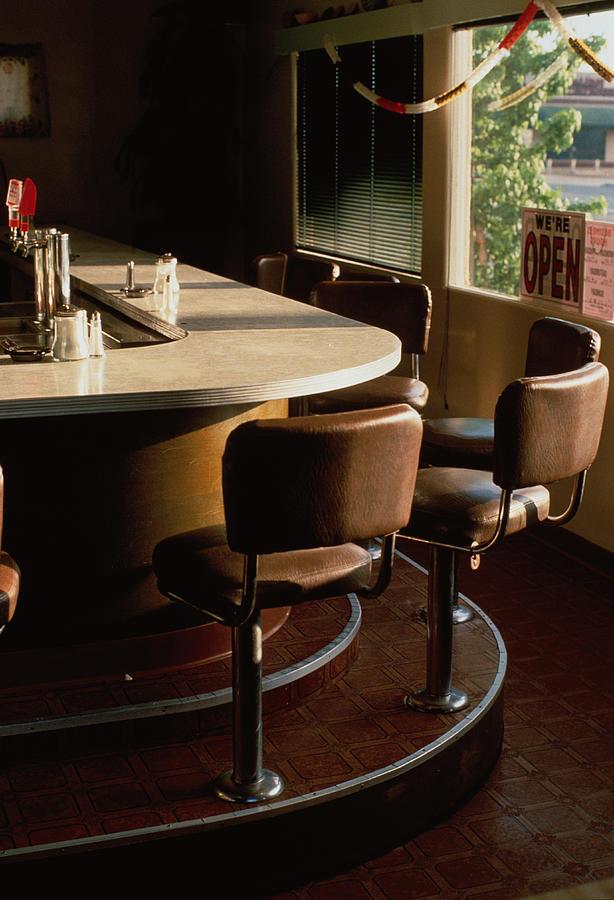 Stools Along Bar Of Diner Photograph by David Zaitz