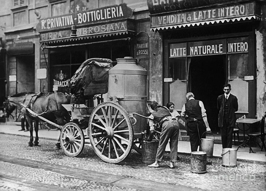 Store Workers Collecting Milk From Wagon Photograph by Bettmann