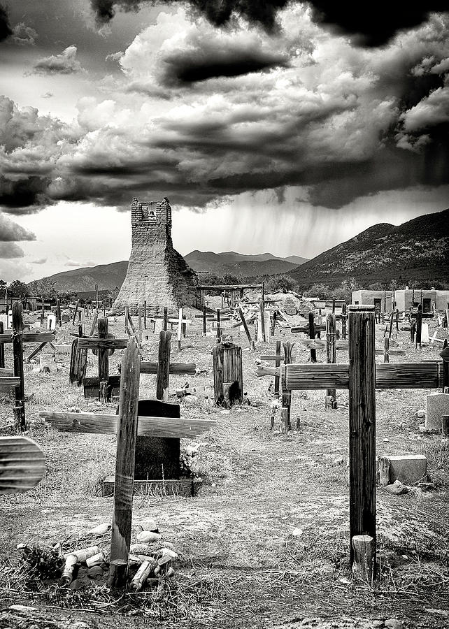 Storm Clouds Over Taos by Ron McGinnis