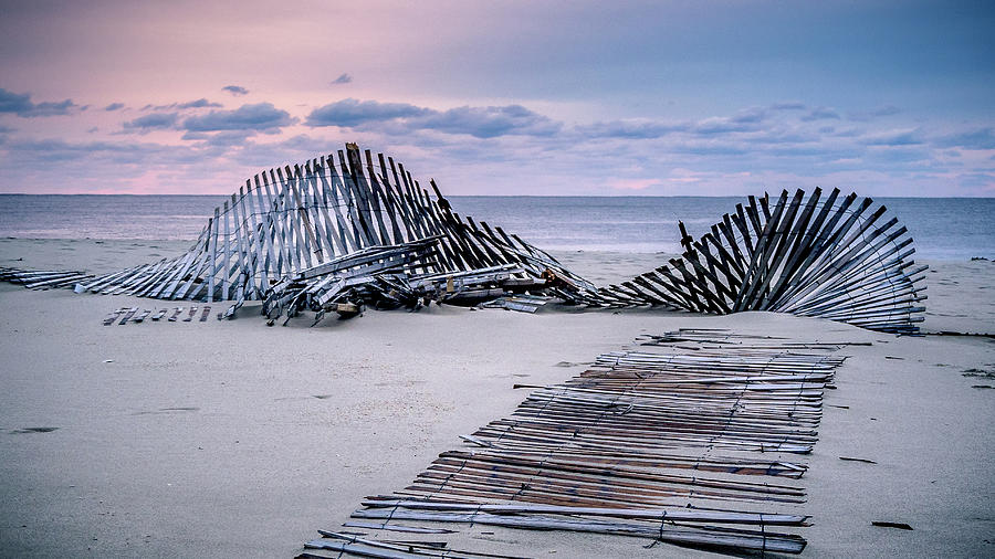 storm fence sunrise by Steve Stanger