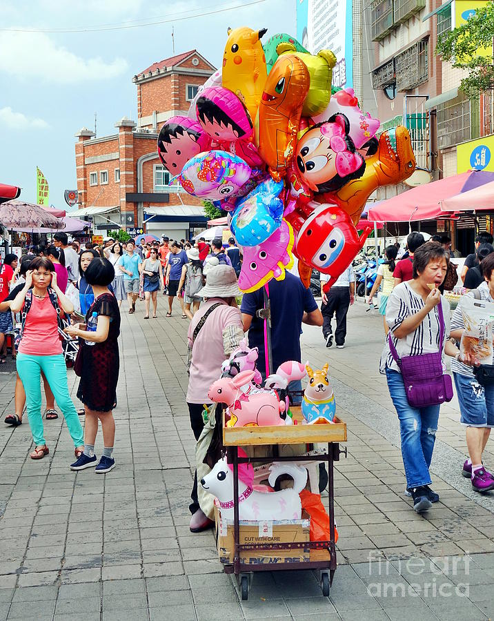 Street Vendor Sells Balloons by Yali Shi