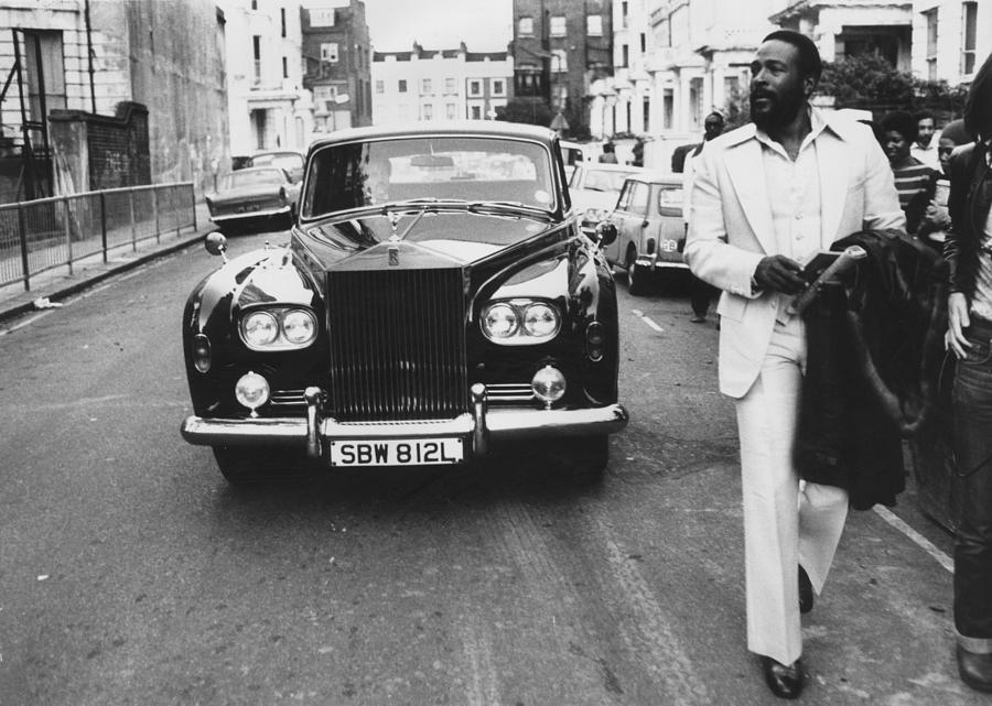 Rolls Royce Photograph - Strolling Soul Singer by John Minihan