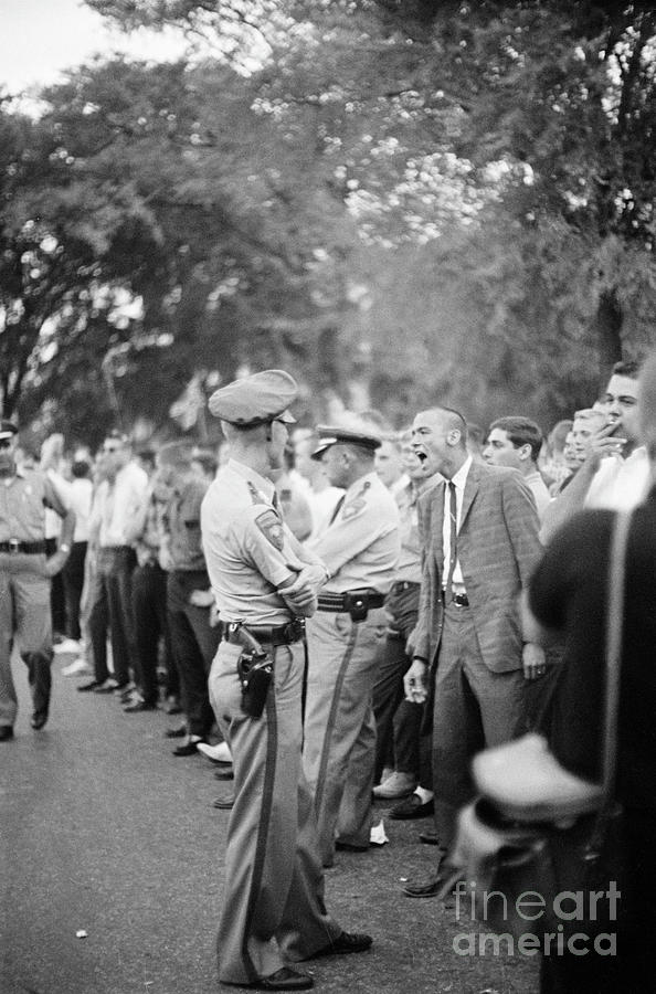 Student Insults Police During Riot Photograph by Bettmann