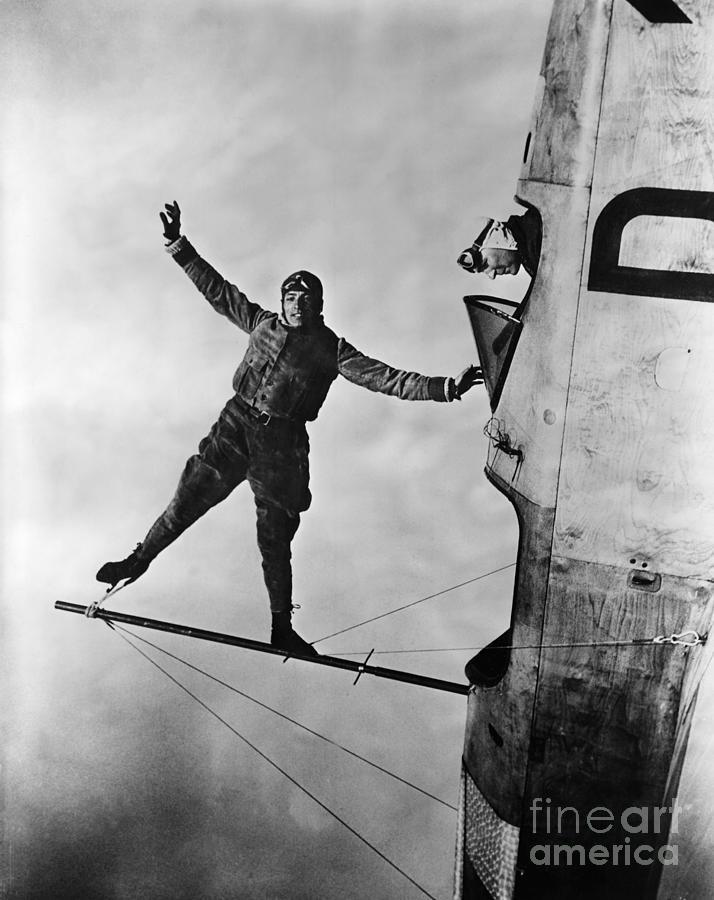 Stunt Flier Suspended Over Cockpit Photograph by Bettmann
