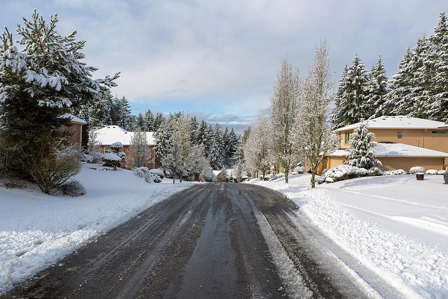 Suburban Neighborhood Street De-Icing on Winter Snow Day by David Gn