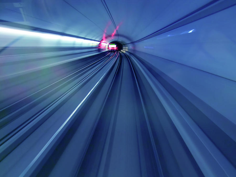 Subway Trains Rushing Through A Tunnel Photograph by Lothar Knopp