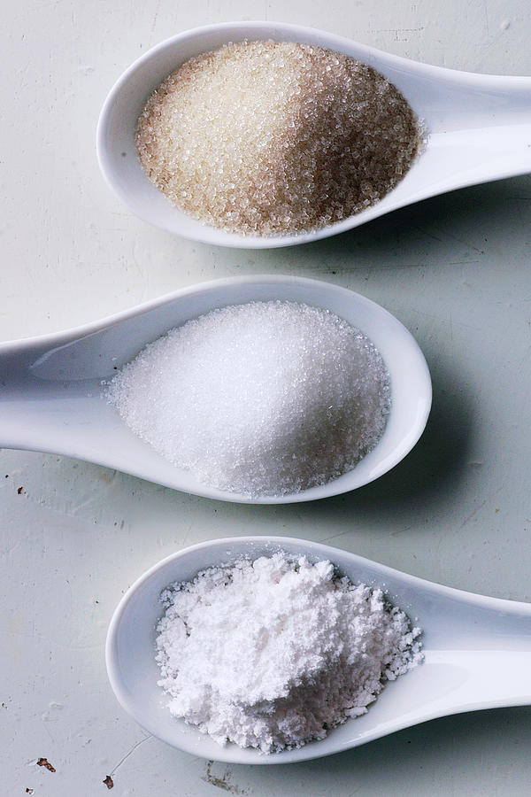 Sugar In Spoons Photograph by Antonios Mitsopoulos