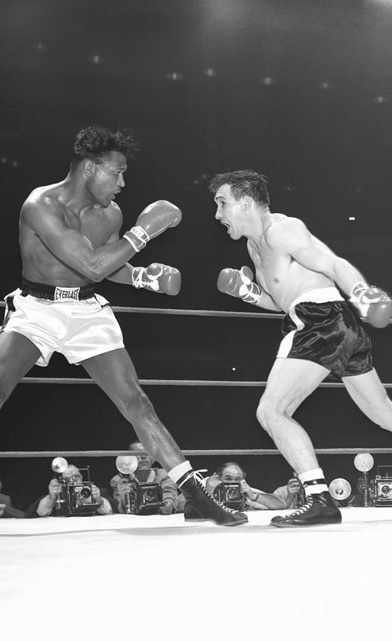 Sugar Ray Robinson Boxing Gene Fullmer Photograph by Bettmann