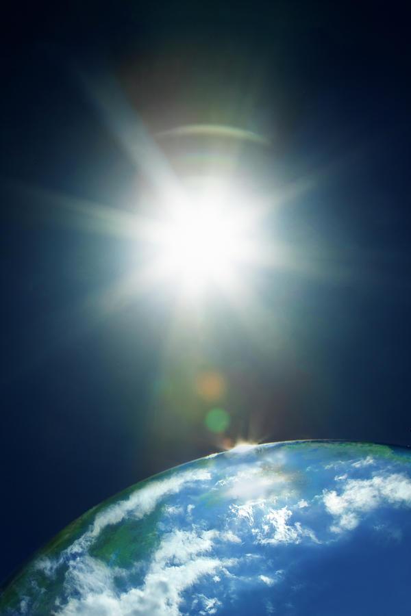 Sun & Earth Photograph by Yuji Sakai