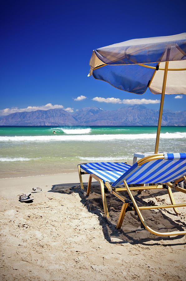 Sun Chairs And Umbrella On Beach Photograph by Mbbirdy