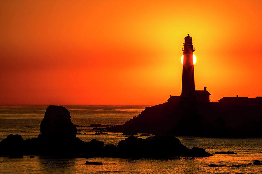 Sun Hiding Behind Lighthouse by Garry Gay