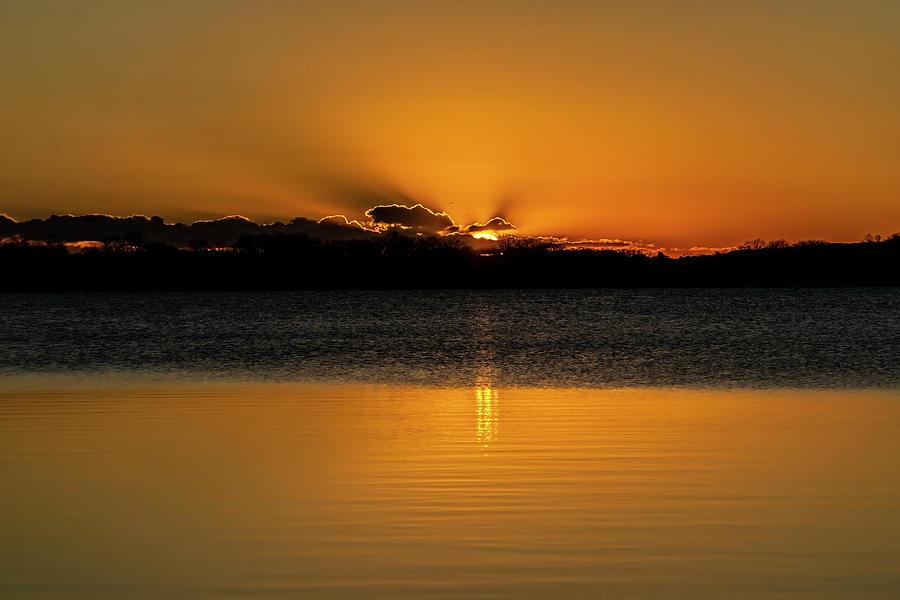 Sun peaking over the clouds on Lake Saske by Sven Brogren