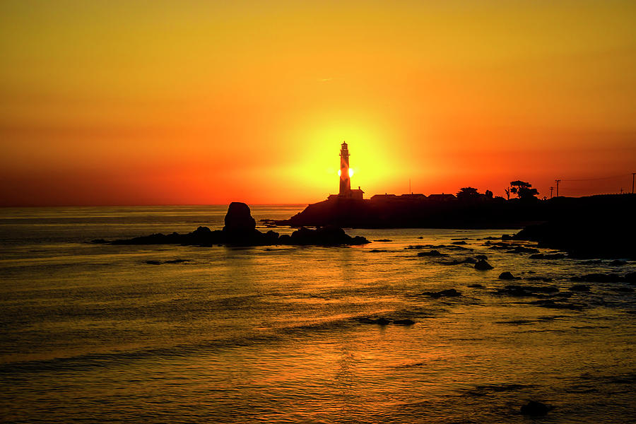 Sun Setting Behind Lighthouse by Garry Gay