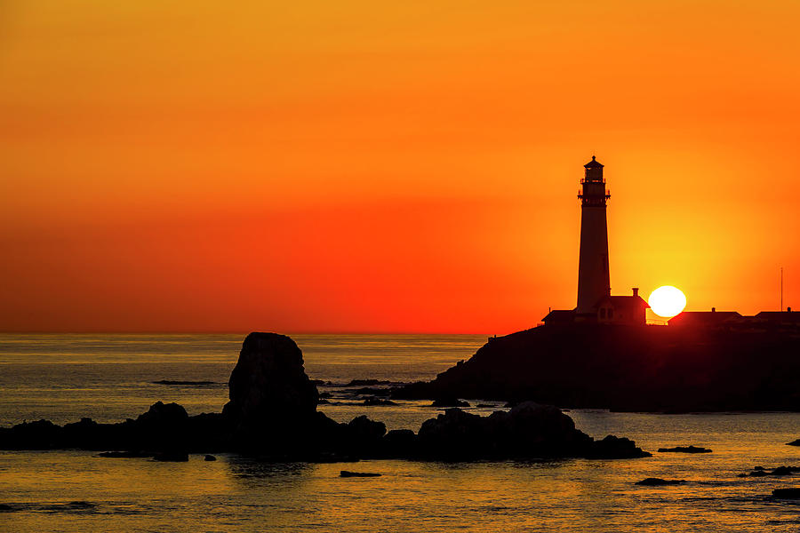 Sun Setting Beyond Lighthouse by Garry Gay