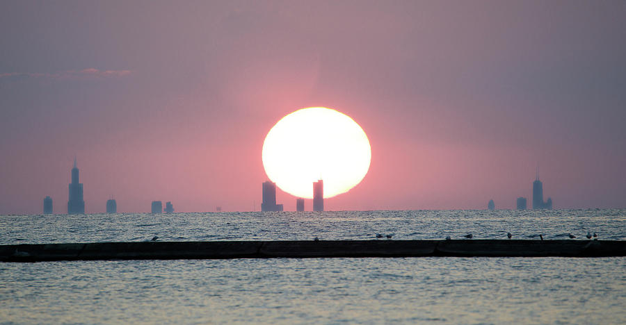 Sun Settting Behind The Chicago Skyline From Michigan City Photograph By Peter Ciro