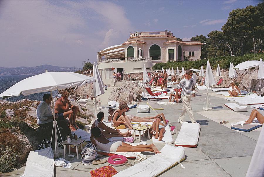 Sunbathing At Hotel Du Cap-eden-roc Photograph by Slim Aarons