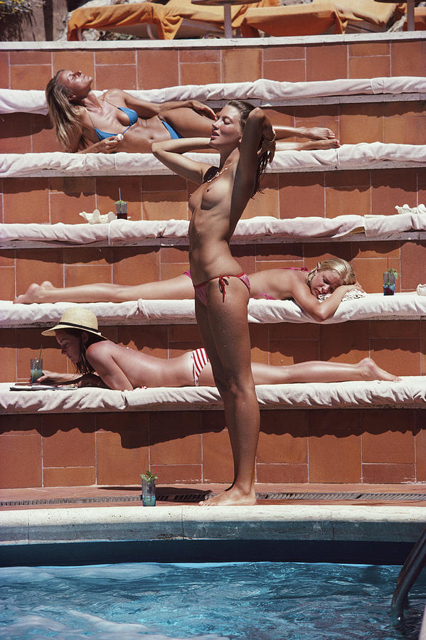 1980-1989 Photograph - Sunbathing On Capri by Slim Aarons