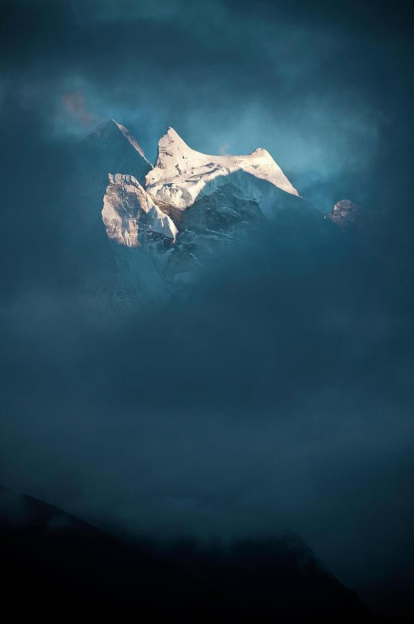 Sunlit Snow Himalaya Peak Dark Swirling Photograph by Fotovoyager
