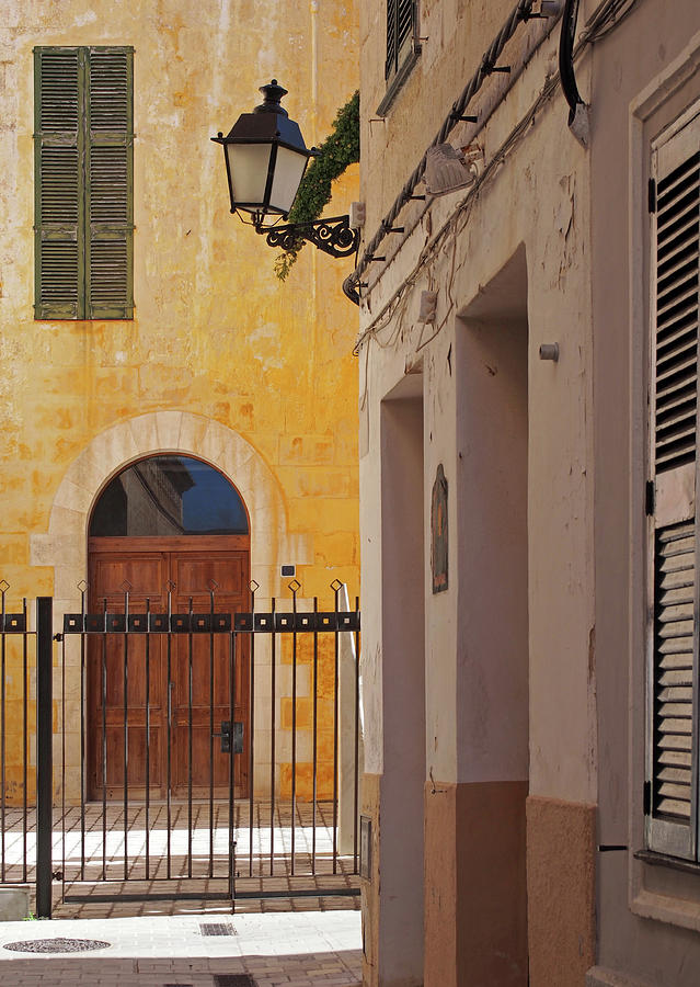 sunlit street in ciutadella by Philip Openshaw