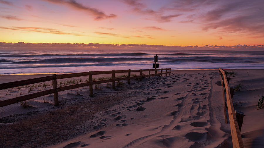 Sunrise after a storm on the beach. by Kyle Lee