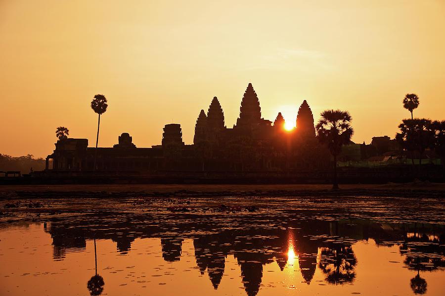 Sunrise At Angkor Wat, Cambodia Photograph by Raisbeckfoto