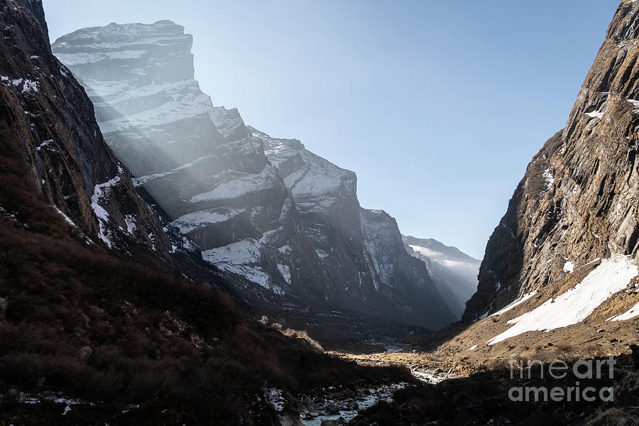 Sunrise over valley leading to the Annapurna base camp trek in N by Didier Marti
