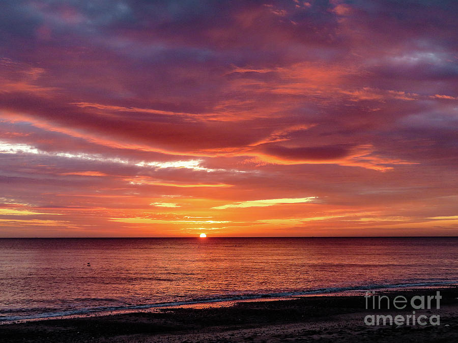 Sunrise over Withernsea Bay by Mandi Hibberd