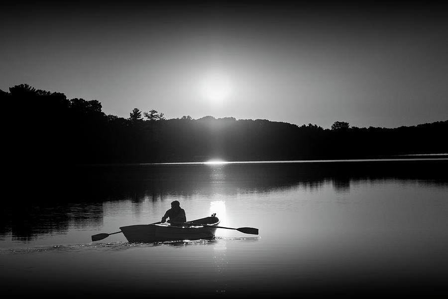 Sunrise with Rowboat crossing Stony Lake in Black and White by Randall Nyhof