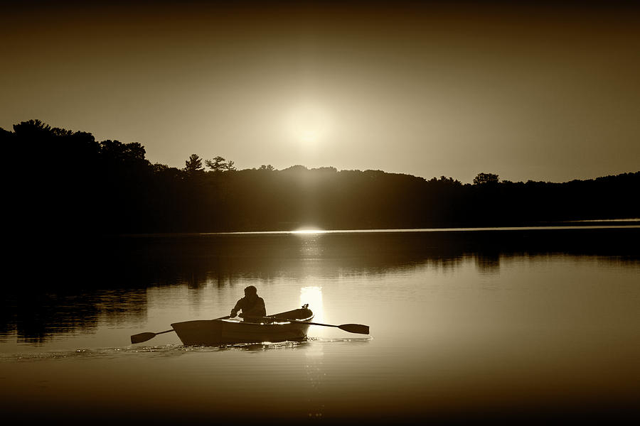 Sunrise with Rowboat crossing Stony Lake in Sepia Tone by Randall Nyhof