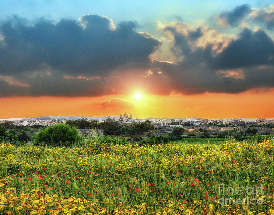 Sunset above a small town in Malta by Stephan Grixti