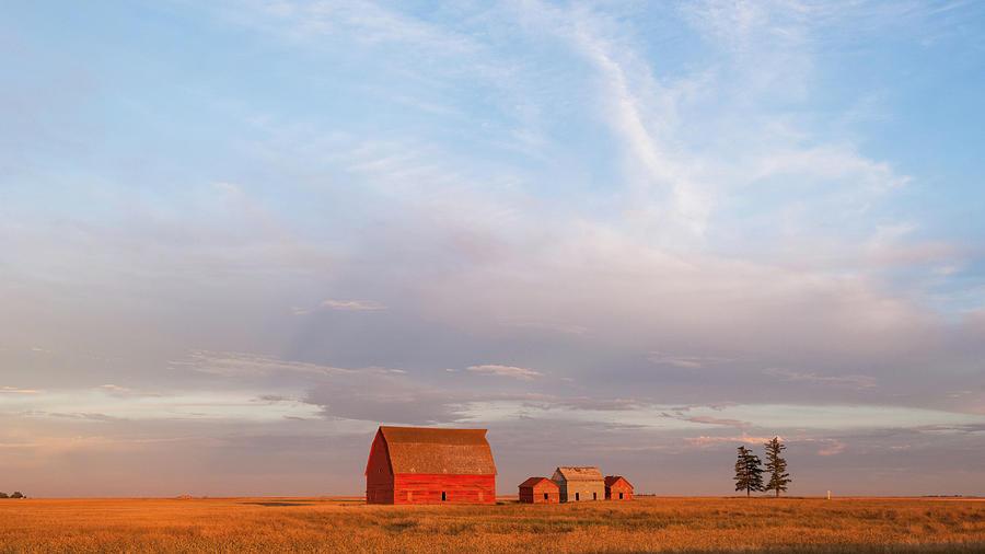 Sunset barns by Yuri San