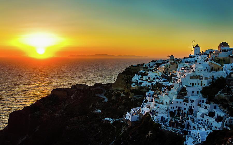 Sunset In Oia, Santorini, Greece Photograph by Marius Roman