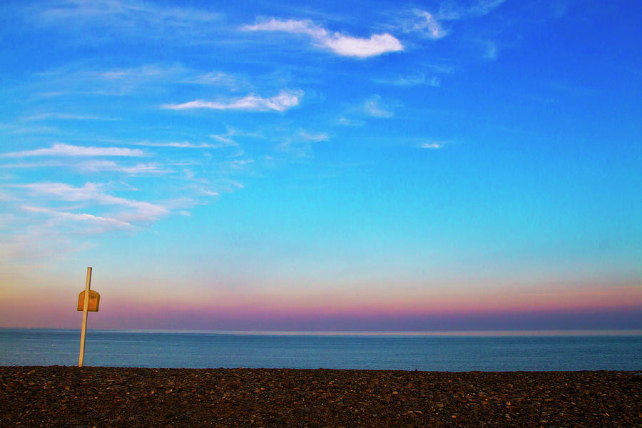 Sunset On Empty Beach With Lifebouy On Photograph by Image By Catherine Macbride