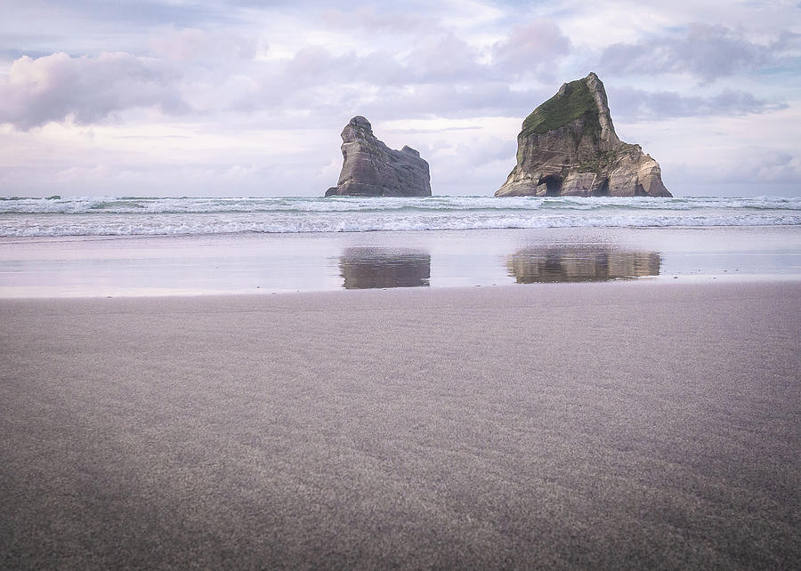 Lonely Islands During Sunset On Wharariki Beach In New Zealand by Peter Kolejak