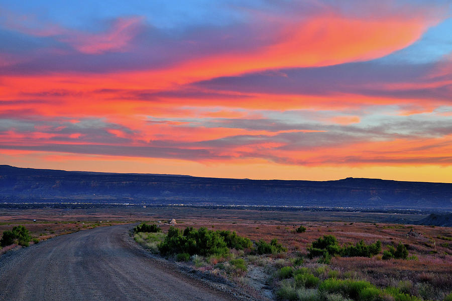Sunset over 27 1/4 Road in Book Cliffs Desert by Ray Mathis