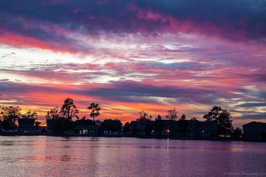 Sunset over cottages on lake moultrie. by Timothy Pinckard