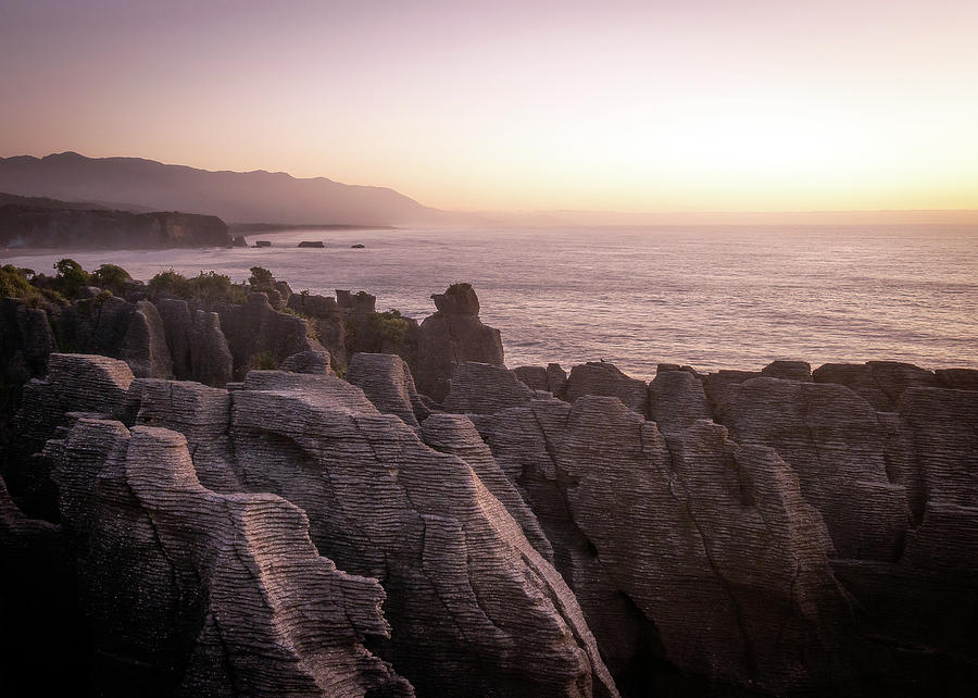 Colorful Coastal Sunset Over Pancake Rocks In New Zealand by Peter Kolejak