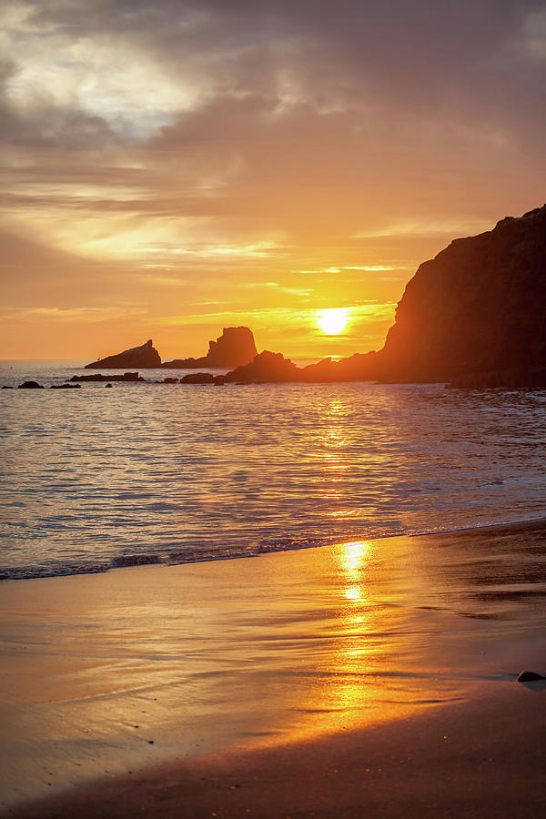 Sunset over Seal Rocks by Cliff Wassmann
