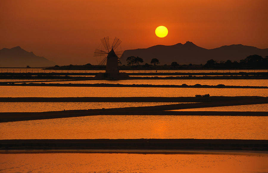 Sunset Over The Saltpans And A Windmill Photograph by Dallas Stribley