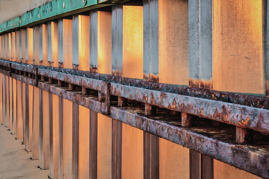 Sunset Reflection On Waterfront Retaining Wall by Gary Slawsky