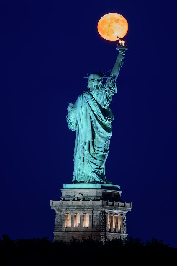 Supermoon Statue Of Liberty by Susan Candelario